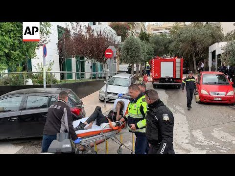 AP: Raw Video: Scenes from hotel fire rescue in central Athens