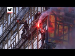 AP: Climate protesters scale new EU headquarters ahead of leaders' summit