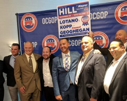 July 2019: Mayor Mo Hill celebrates his election win at campaign headquarters with members of the Toms River Jewish Community Council and Agudath Israel of America.